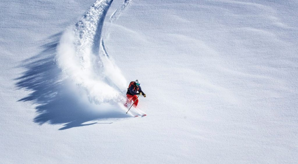 Expert free ride skiing in powder snow