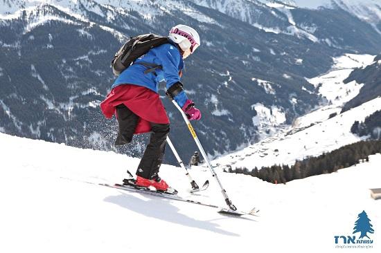 קטועת רגל גולשת סקי